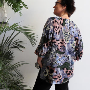 Lucy In The Sky Blouse, a kaftan style summer top in safari animal print. Lavender Blue back.