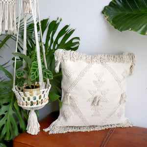 Large throw cushion in natural cotton with boho decorating style. 60cm x 60cm