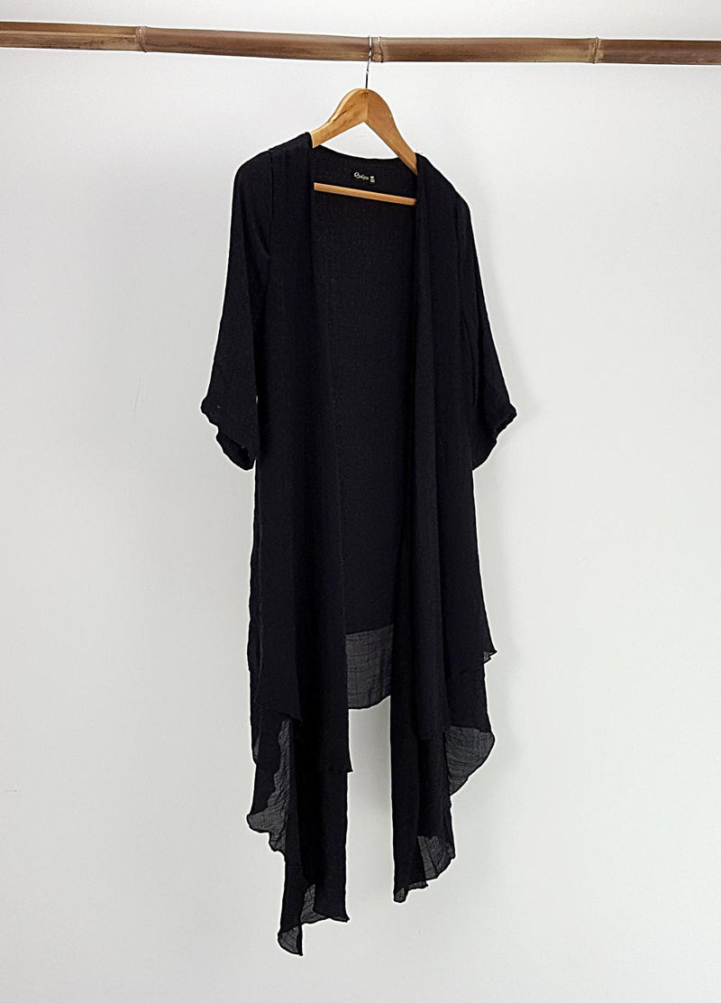 Make It Happen Long Layer Cardigan is a lightweight summer cover-up. Black.