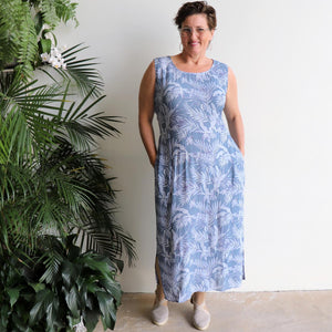 Malibu Dress with sash-tie belt in a Palm Leaf print. Below the knee women's summer dress with elastic back and pockets. Made from quality rayon. Denim Blue.