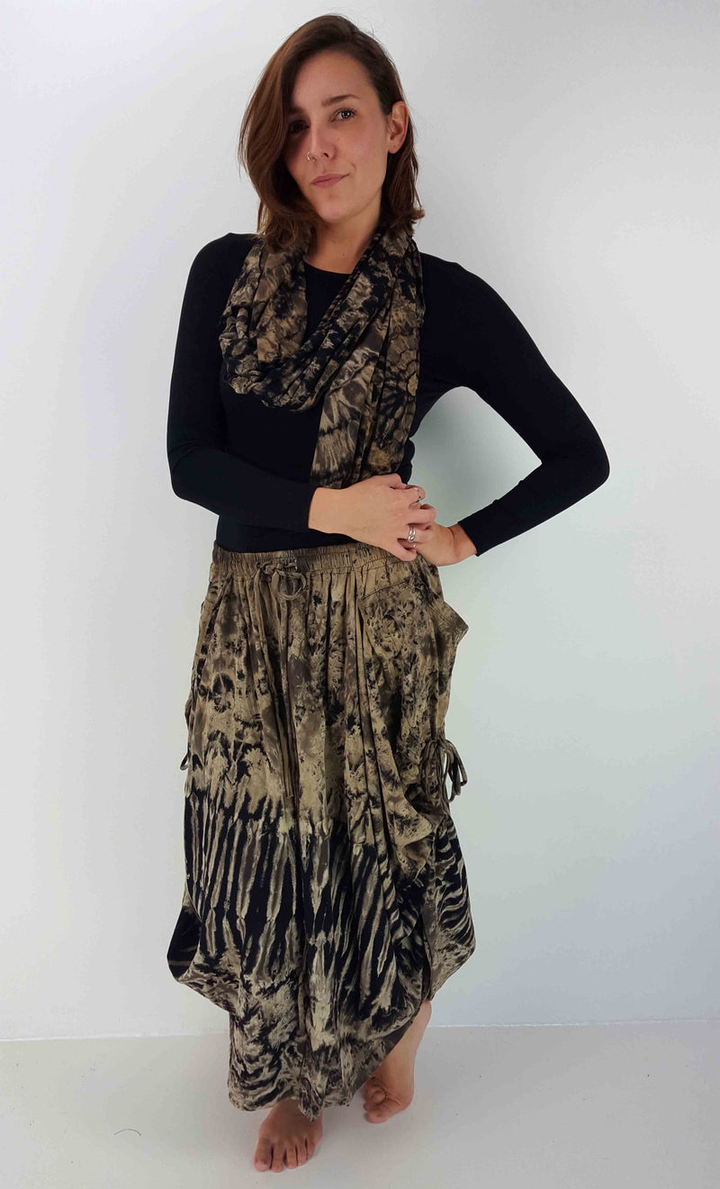 Heavy cotton maxi skirt with reverse tie-dye design. Side tie features + buttons to convert skirt into cullott pants.