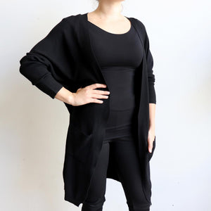Misty Morning Cardigan, a loose fitting, stretch feel winter cardi. Created with two handy side pockets. Cotton-Poly-Spandex blend. Black.