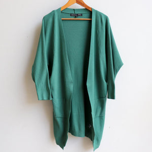 Misty Morning Cardigan, a loose fitting, stretch feel winter cardi. Created with two handy side pockets. Cotton-Poly-Spandex blend. Sage.