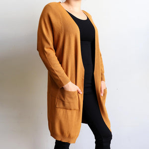 Misty Morning Cardigan, a loose fitting, stretch feel winter cardi. Created with two handy side pockets. Cotton-Poly-Spandex blend. Tan.