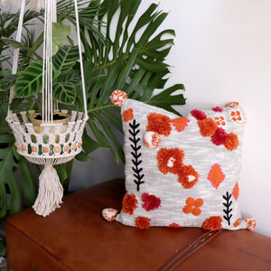 Scandi style throw cushion!. With corner pompoms and abstract floral motif in burnt orange, silver, cream and black, 45cm x 45cm