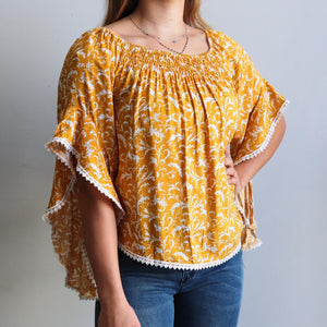 Moondance Blouse a gypsy inspired womens top in a pretty floral print. True to size fitting summer top made in rayon fabric. Sizes 8-16. Buttercup Yellow.