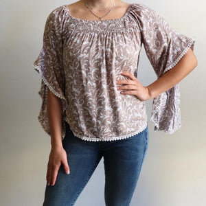 Moondance Blouse a gypsy inspired womens top in a pretty floral print. True to size fitting summer top made in rayon fabric. Sizes 8-16. Sand.