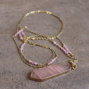 Stone pendant with faceted glass bead features along a fine gold-plated chain. Rose Quartz.