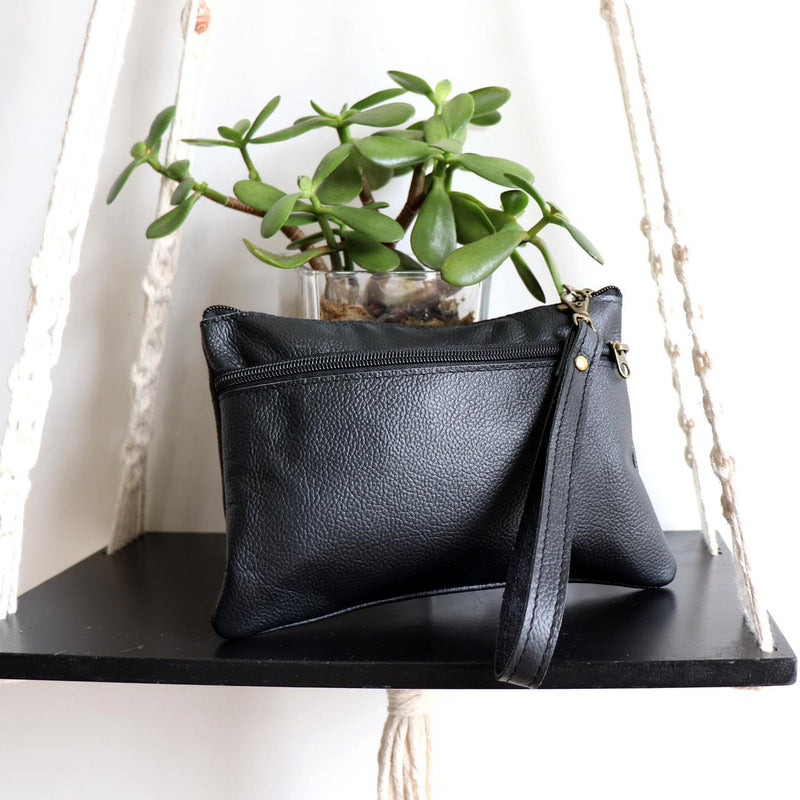 Handmade genuine leather clutch with zippered closure, separate side compartment with wrist strap. Fits your phone, keys and wallet too. Black.