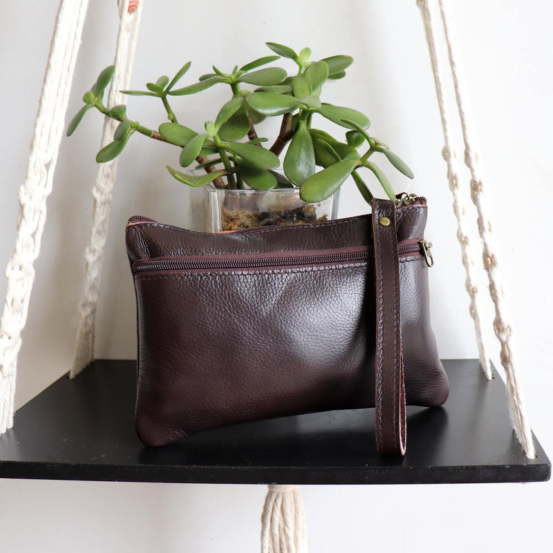 Handmade genuine leather clutch with zippered closure, separate side compartment with wrist strap. Fits your phone, keys and wallet too. Dark Brown.