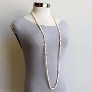 Freshwater baroque pearls hand knotted to create a long strand of 125cm.