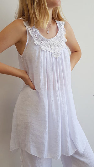 Light + floaty womens beach cover up tunic top / dress with cotton lace detailing. Round neck sleeveless summer dress. White