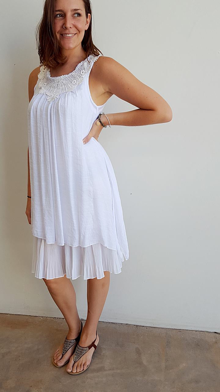 Light + floaty womens beach cover up tunic top / dress with cotton lace detailing. Round neck sleeveless summer dress. White.