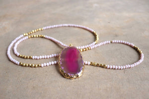 Stunning glass and stone statement necklace with gold metallic hightlights. Pink.