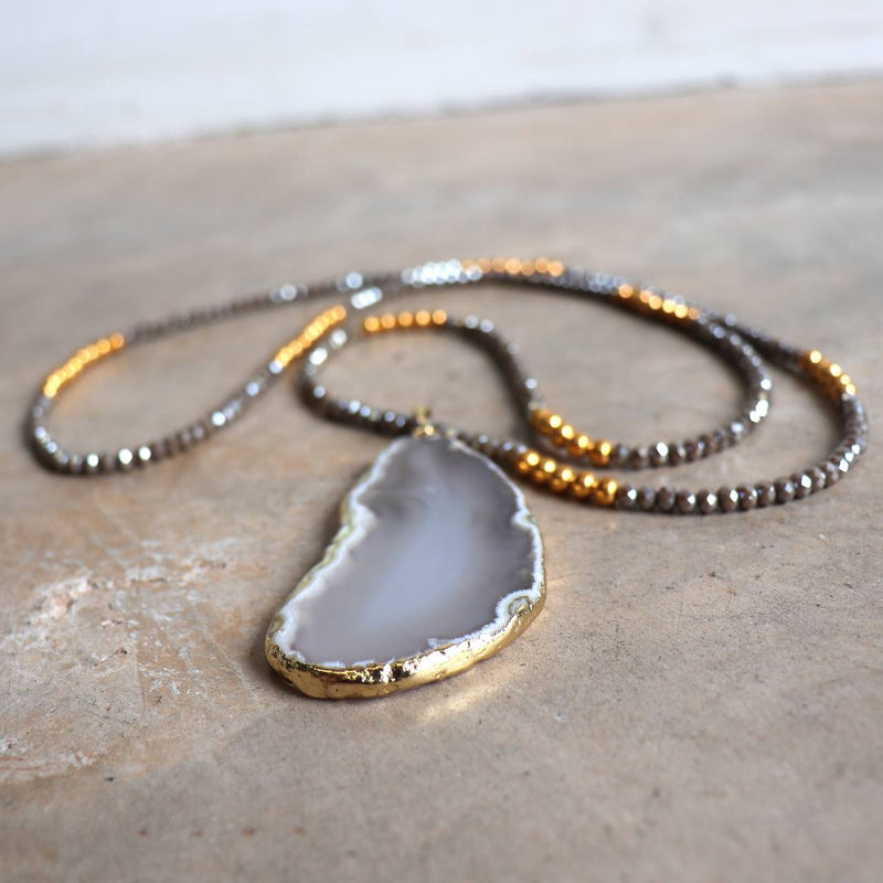 Stunning glass and stone statement necklace with gold metallic hightlights. Storm Grey.