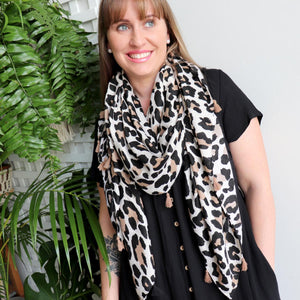 On Safari Scarf - luxe animal print winter accessory with tassels.