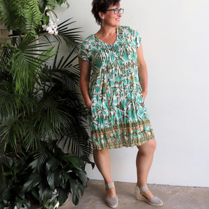 Women's short-sleeved Summer Tunic Dress. 100% cotton in sizes 10 - 20. Turquoise Floral.