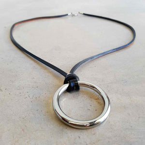 Black leather medium necklace with metal ring pendant.