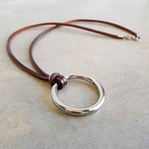Brown leather medium necklace with metal ring pendant.