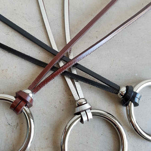 leather medium necklace with metal ring pendant.
