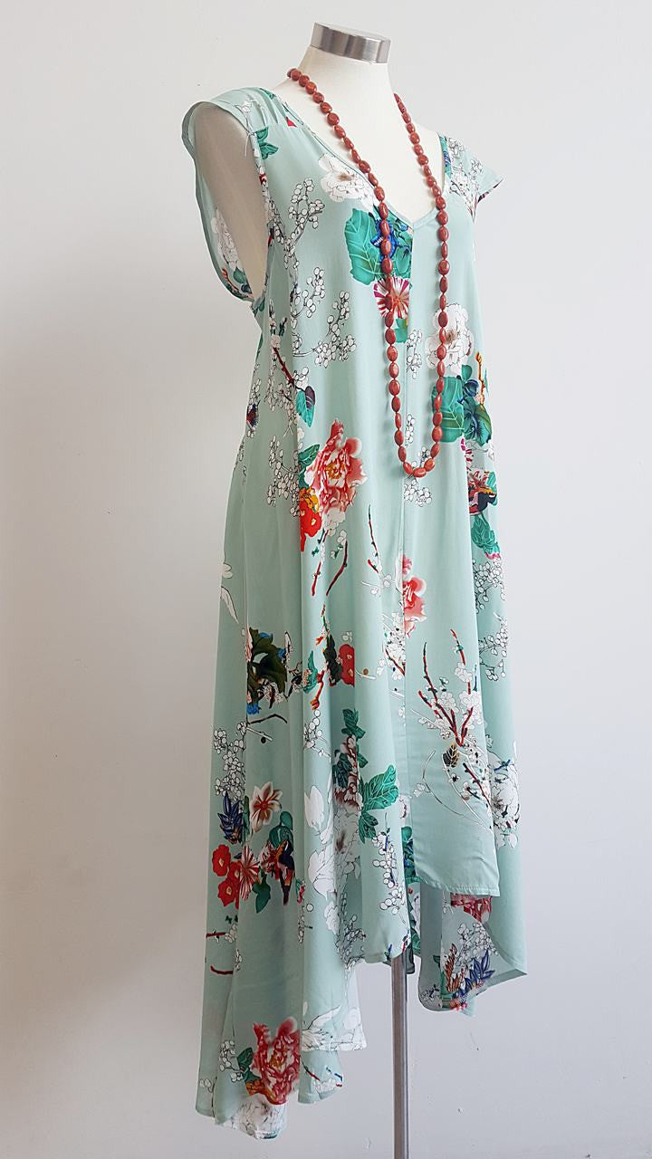 'Oriental Spring' womens light rayon summer dress with cap sleeve. A feminine design with a full-skirted cut that dips longer at the back