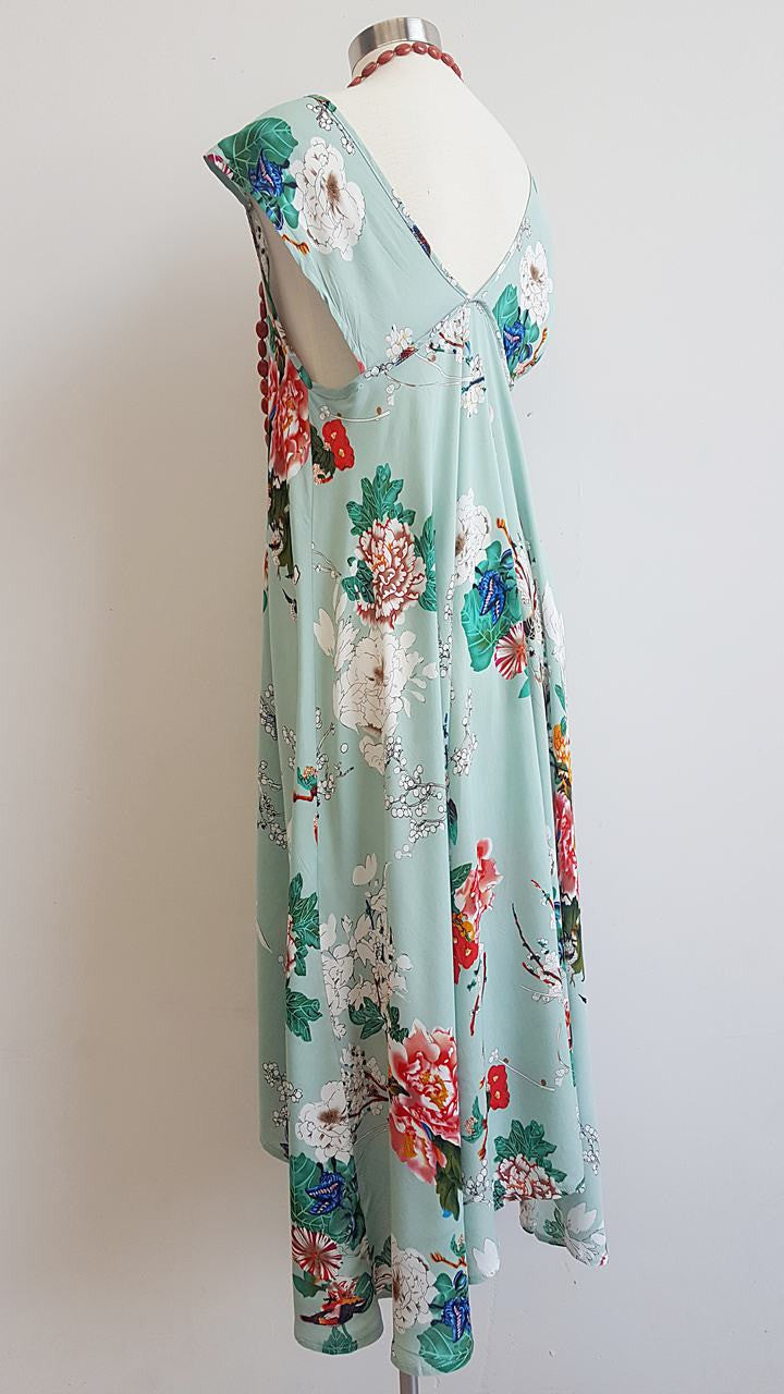 'Oriental Spring' womens light rayon summer dress with cap sleeve. A feminine design with a full-skirted cut that dips longer at the back.