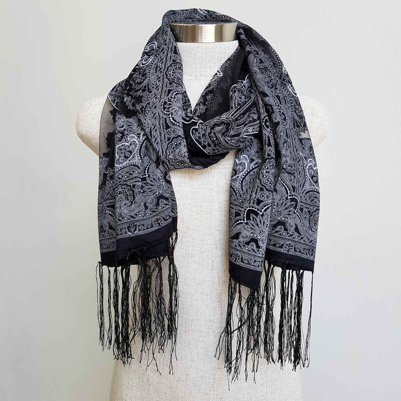 Beautiful fine paisley printed sheer scarf with fringing.  Black.