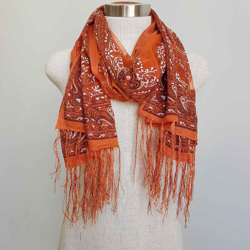 Beautiful fine paisley printed sheer scarf with fringing. Brick Red