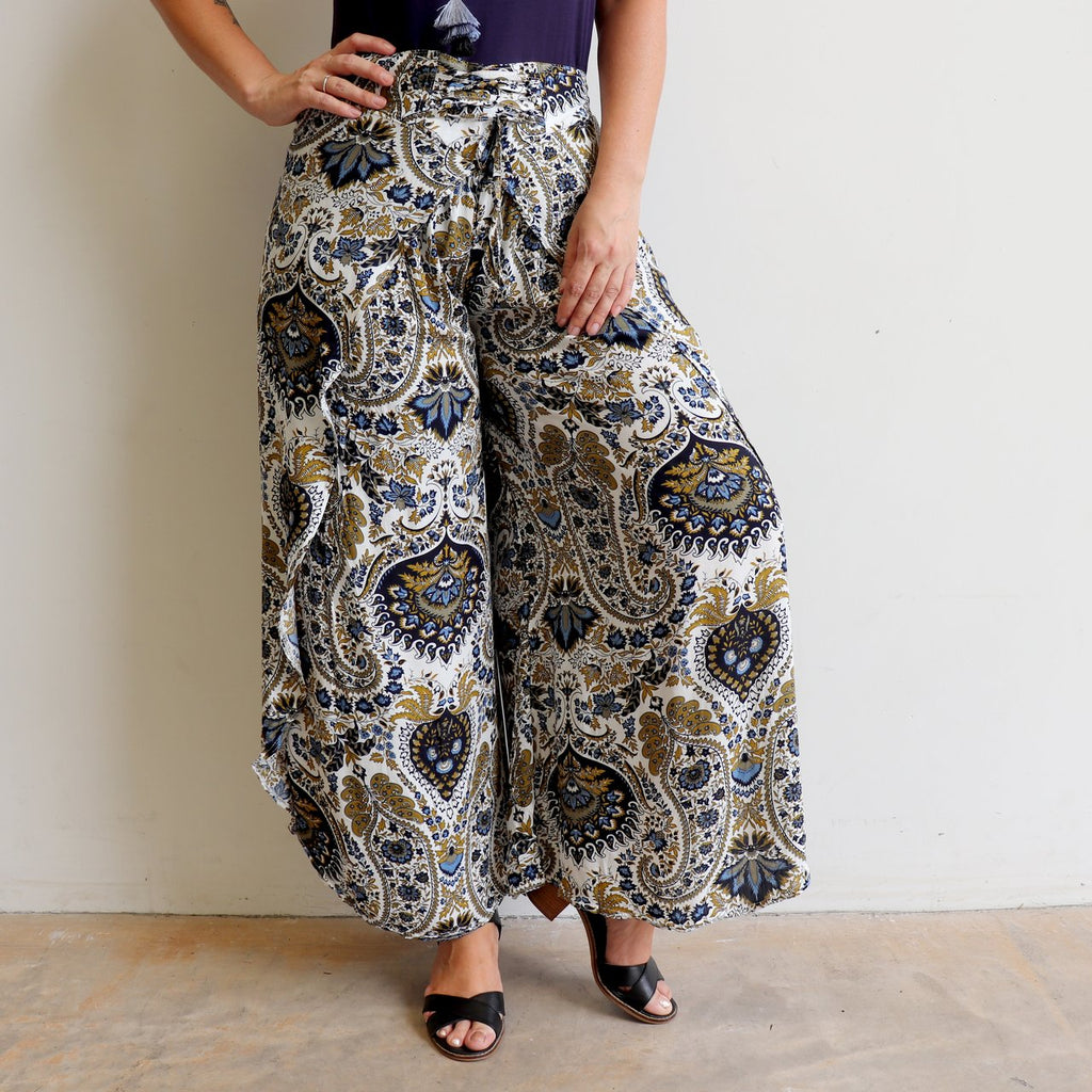Palazzo Pants with wrap-leg style and a lace-up waistband. Easy pull-on style trousers sizes 8 to 18 in classic paisley print.