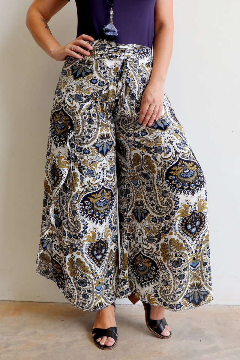 Palazzo Pants with wrap-leg style and a lace-up waistband. Easy pull-on style trousers sizes 8 to 18 in classic paisley print
