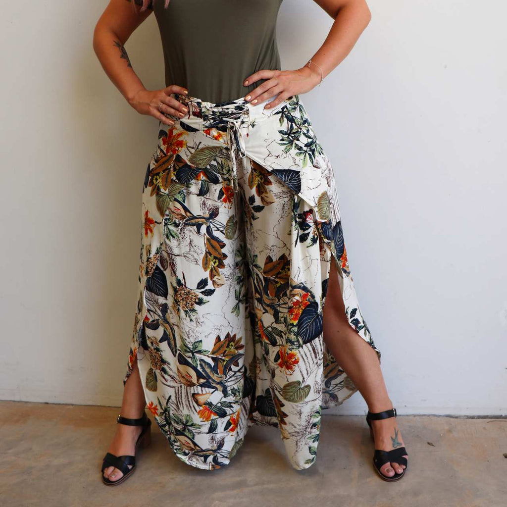 Palazzo Pants with wrap-leg style and a lace-up waistband. Easy pull-on style trousers sizes 8 to 18 in fun tropical jungle print.
