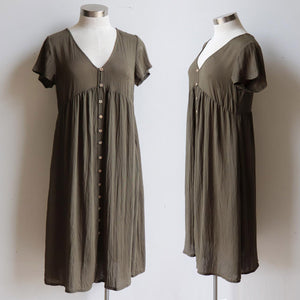 Made from a softly draping linen-blend fabric and designed for cruisy summer days. Short Sleeve Dress with full button front and below the knee hemline. In sizing options from 6 to 20. Olive Green.