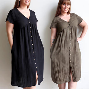 Made from a softly draping linen-blend fabric and designed for cruisy summer days. Short Sleeve Dress with full button front and below the knee hemline. In sizing options from 6 to 20.