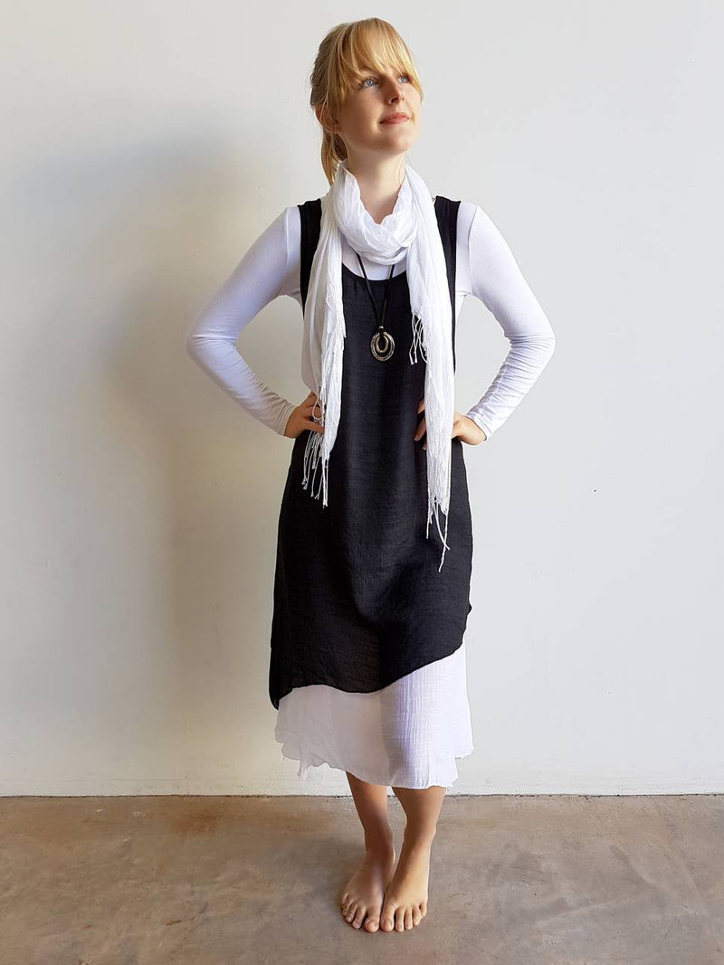Light + floaty textured cotton blend womens sleeveless summer dress with a-symmetrical layer hem + round neck.  Black/