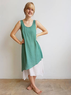Light + floaty textured cotton blend womens sleeveless summer dress with a-symmetrical layer hem + round neck.  Sage Green.