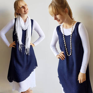 Light + floaty textured cotton blend womens sleeveless summer dress with a-symmetrical layer hem + round neck.  Navy.