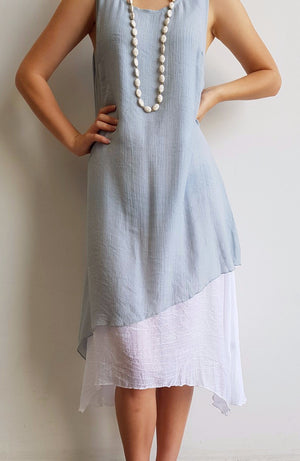 Light + floaty textured cotton blend womens sleeveless summer dress with a-symmetrical layer hem + round neck. Silver