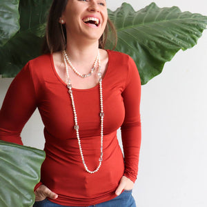 Silky soft cotton tee with plenty of stretch. Great for winter layering. Sunset Red.