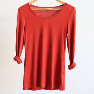 Cotton Long Sleeve T-shirt is an essential winter wardrobe basic made for layering. Sunset Red. Hanger view..