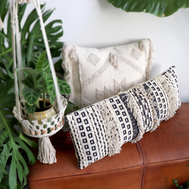 Funky boho-style long bolster throw cushion in natural cream cotton weave. Measuring a generous 35cm X 90cm