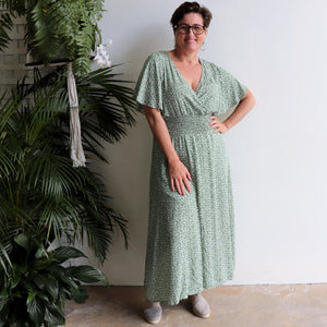 Pretty Woman Floral print midi-length Summer Dress. Made with soft rayon fabric with fluted sleeves + elasticated waistline in sizes 12/14 to 20/22. Forest Green.