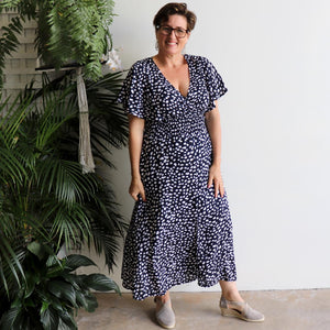 Pretty Woman Spot print midi-length Summer Dress. Made with soft rayon fabric with fluted sleeves + elasticated waistline in sizes 8/10 to 20/22. Navy Blue.
