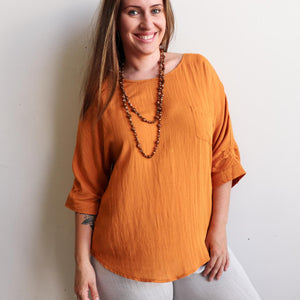 Avoca Blouse with 3/4 sleeve made in linen blend fabric. Pumpkin
