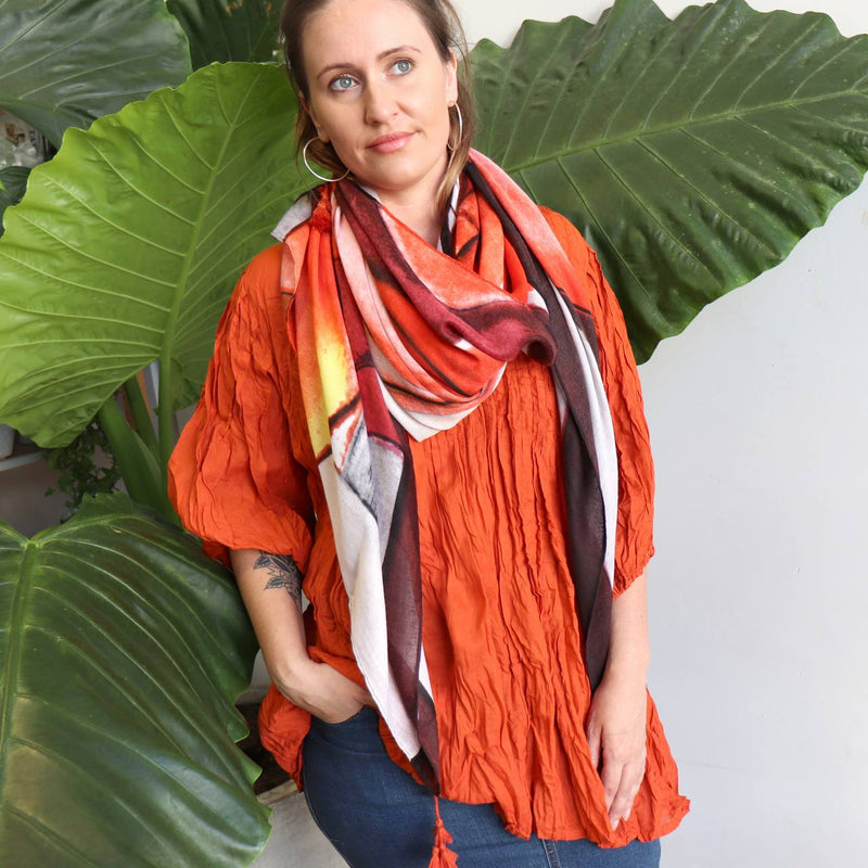Wonderfully oversized scarf with abstract warm reds accented with ochres and mustard tones. Easy wash and wear fabric 100% Poly.