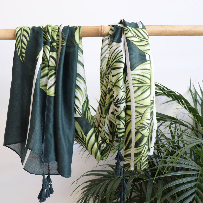 Wonderfully oversized scarf with an abstract leafy green print with mustard tones. Easy wash and wear fabric 100% Poly.