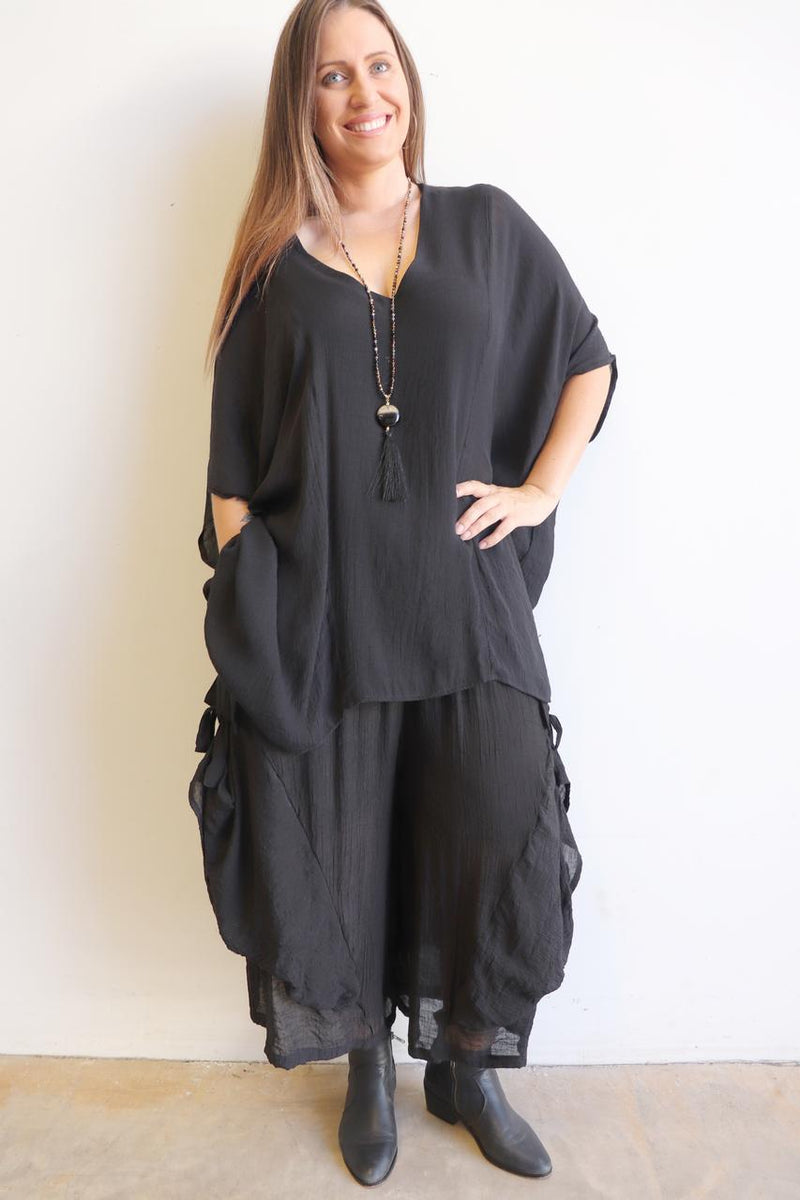 Dramatic ankle-length, wide-leg lounge pants designed for layering. Plus size. Black.