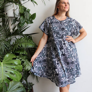 Savvy Sun Dress in animal print is a loosely styled summer dress with short sleeves and below-the-knee hemline fitting up to plus size. Black.