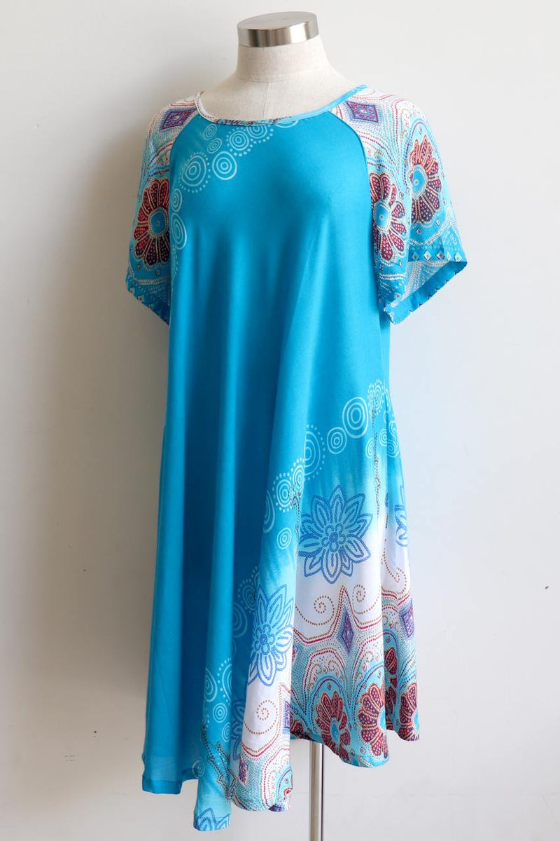 Short Sleeve two-toned rayon tunic dress. Free-flowing with round neck and Scalloped Hem. Onesize, fits 10 - 18 plus. Turquoise.