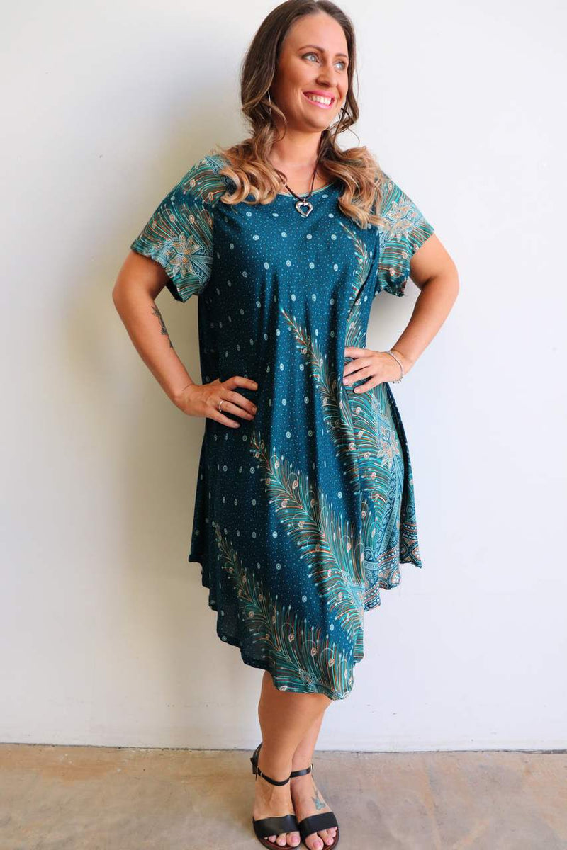 Short sleeve and below-the-knee hemline on this cool, comfortable summer dress. Free flowing to fit sizes up to plus size.