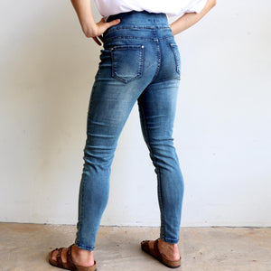 Shaper Denim Jeans - mid-rise stretch pull-on jegging in plus size. Back side view.